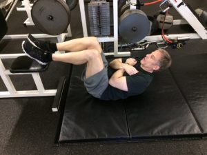 crunches with hands on chest